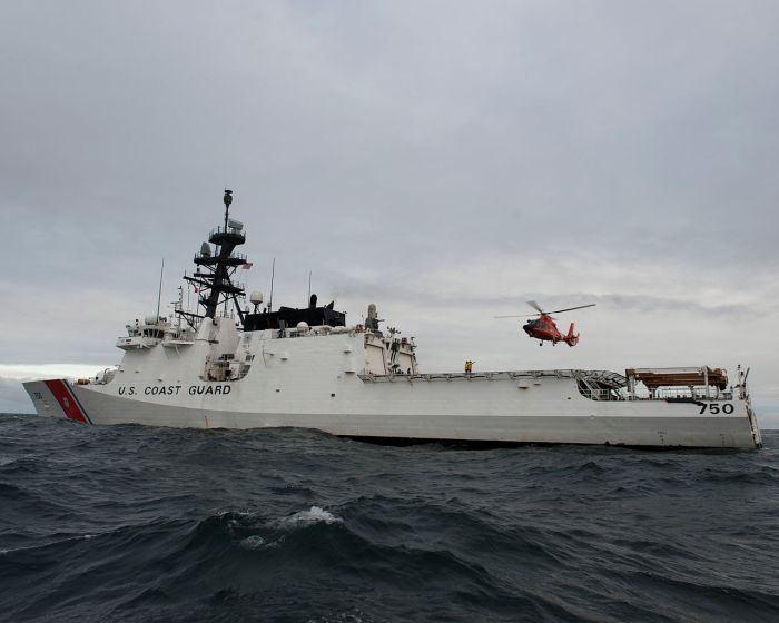 1280px-A_U.S._Coast_Guard_MH-65_Dolphin_helicopter_flies_by_the_national_security_cutter_USCGC_Bertholf_(WMSL_750)_in_the_Arctic_Ocean_Sept_120914-G-VS714-527