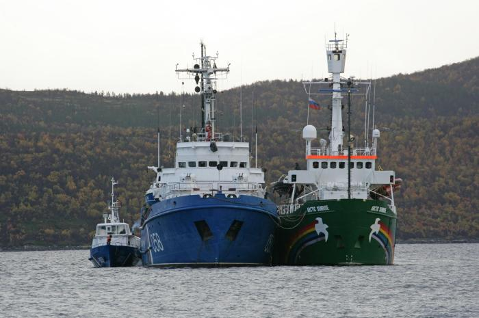 The Greenpeace ship, Arctic Sunrise is towed into Murmansk port by a Russian Coast Guard vessel. The activists onboard are facing possible charges of piracy in Russia for a protest against Arctic oil drilling in the Pechora Sea.