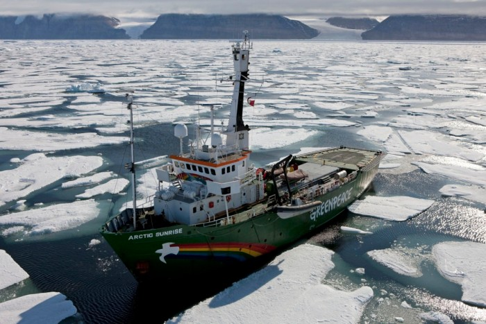 The Greenpeace ship MY Arctic sunrise pictured in cracked and drifting ice in front of the Petermann glacier (out of shot to the left) This is the zone where the glacier's front meets the sea and starts to break up. This is the furthest point that the ship can get to the front of the glacier to begin research via helicopter, inflatable and perhaps by foot/ skis. Greenpeace and leading climate scientists are in Greenland for a 3 month expedition using their icebreaking ship the Arctic Sunrise to gather climate change data for the Copenhagen climate summit in December 2009.